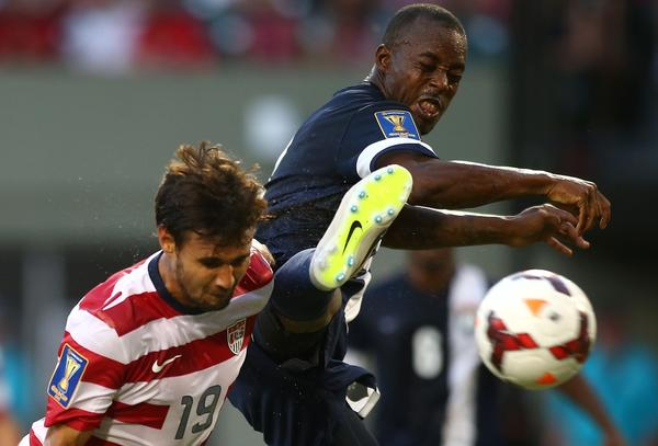 Belize's Elroy Smith, right, can't stop Chris Wondolowski of the United States from heading in his third goal of the first half during the USA's 6-1 victory.
