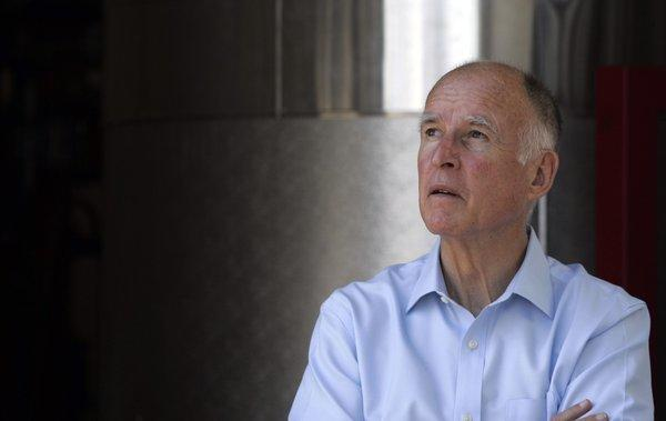 Gov. Jerry Brown signs into law two measures intended to revamp the state's economic development programs.