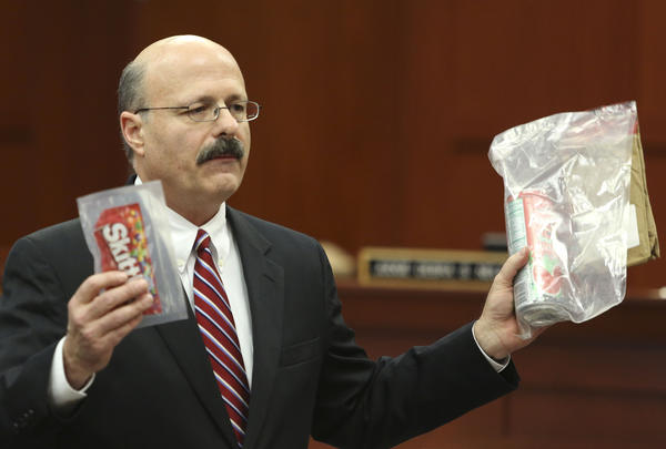Assistant state attorney Bernie de la Rionda holds up evidence to the jury while presenting the state's closing arguments against George Zimmerman during his trial in Seminole circuit court in Sanford, Fla. Thursday, July 11, 2013. Zimmerman has been charged with second-degree murder for the 2012 shooting death of Trayvon Martin. (Gary W. Green/Orlando Sentinel)