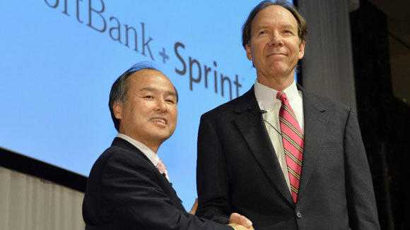 Masayoshi Son (left), president of Japan's mobile carrier Softbank, shakes hands with Sprint CEO Dan Hesse to seal Softbank's deal to buy Sprint last year in Tokyo.
