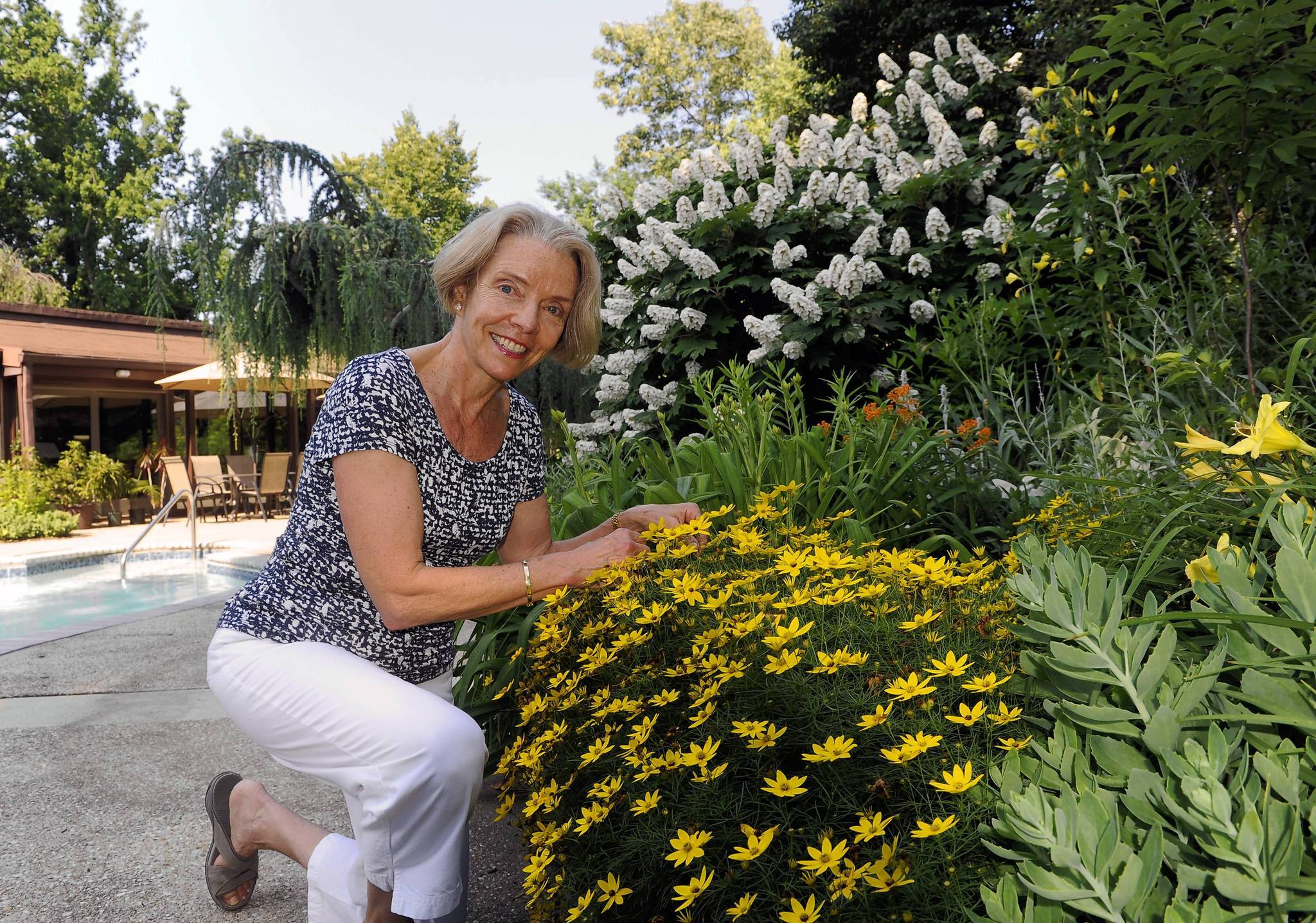 Cristina Quigley, who along with her husband Harry, is a winner of the overall garden contest.