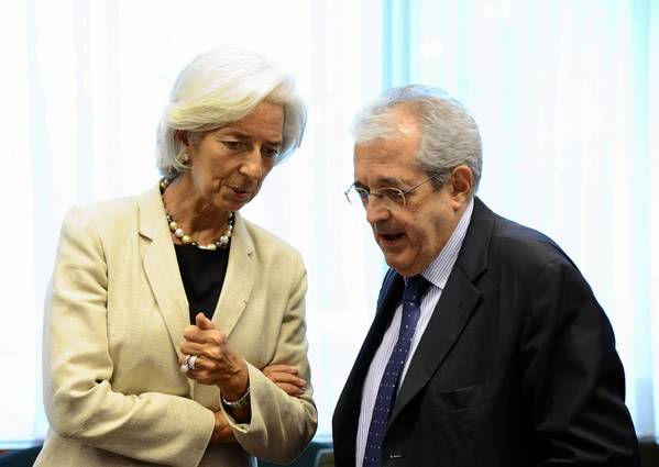 International Monetary Fund Director General Christine Lagarde (left) speaks with with Italian Finance Minister Fabrizio Saccomanni on July 8 before a meeting of Eurozone finance ministers at EU headquarters in Brussels.