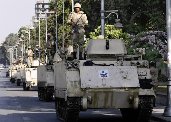 Egyptian soldiers stand guard near the presidential palace in Cairo. The Muslim Brotherhood has called for supporters to turn out en masse Friday to demand Mohamed Morsi's reinstatement as president.