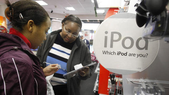 Latangya Clinton and her daughter Vanessa check out iPod speakers at a Fort Worth, Texas, RadioShack in a 2007 file photo.