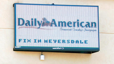 The Daily Americans Electronic Message Center provides photos, news headlines and advertisements.