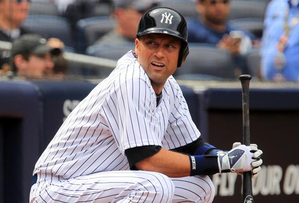 Yankees designated hitter Derek Jeter waits on deck to bat in the 6th inning against the Kansas City Royalsduring the game at Yankee Stadium. Mandatory Credit: John Munson/THE STAR-LEDGER via USA TODAY Sports ORG XMIT: USATSI-123064