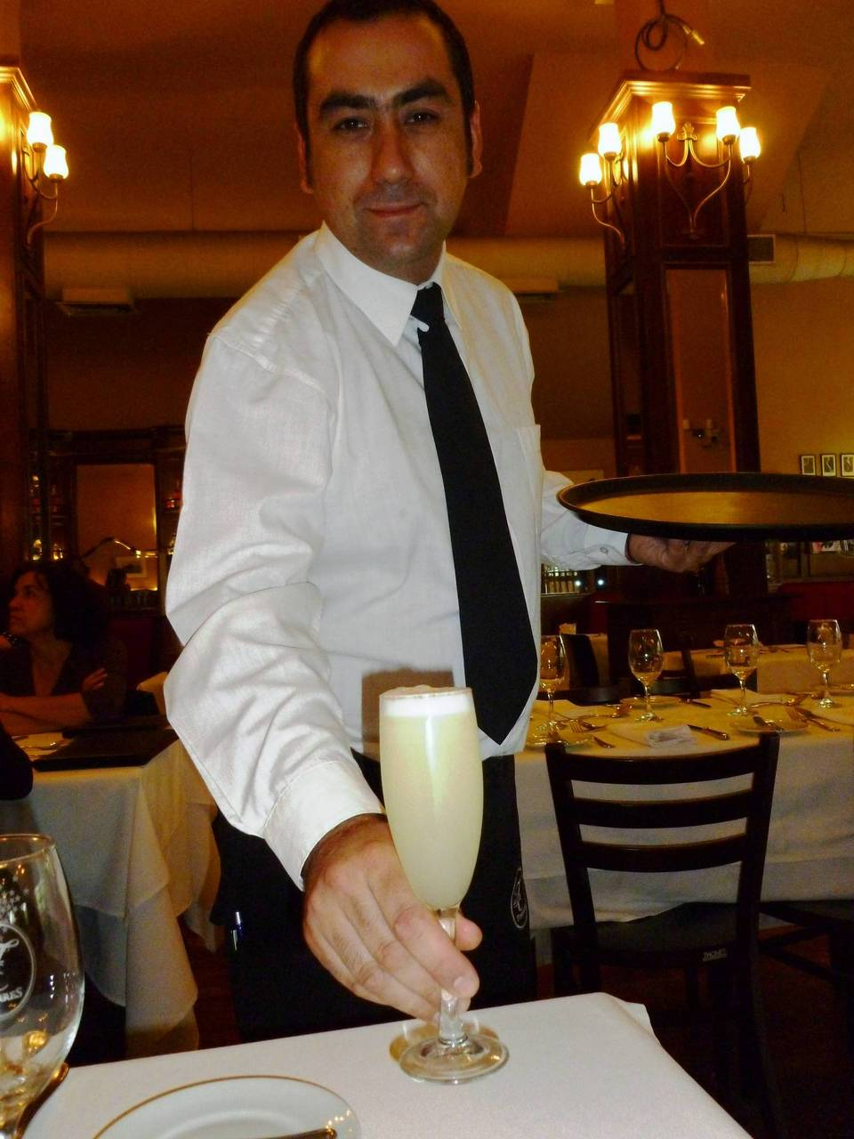 A frothy pisco sour rates black tie service at Confiteria Torres, one of Santiago's most venerated restaurants, since 1879.