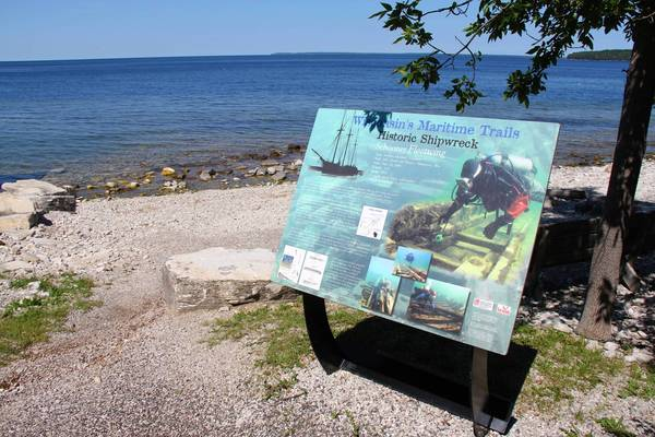 A plaque denotes the site in Garrett Bay where the Fleetwing ran a