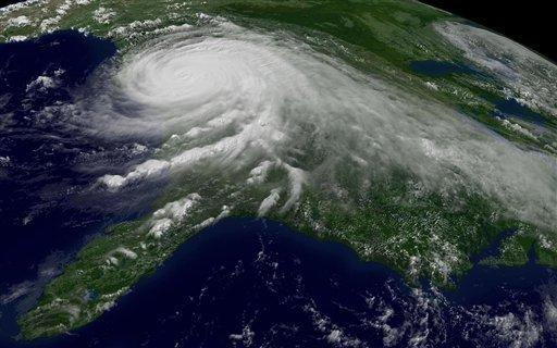 Hurricane Katrina encompasses most of the Gulf Coast in this Aug. 29, 2005, satellite photo. An Energy Department report warns that rising temperatures and high seas threaten power plants across the country, and that climate change is making severe storms more frequent. Katrina remains the most expensive natural disaster in U.S. history.