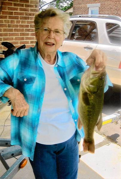 Gene-Hope Johnson, 84 of Macungie, shows off he 17.5-inch, 3-pound largemouth bass she caught using a Senko worm in Lake Nockamixon whiel fishing with John Flamisch.