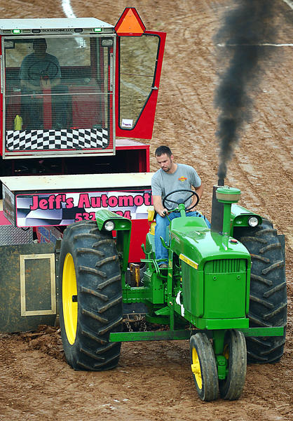 Mike Niswander pulls the weight sled more than 205 feet during Thursday's antique tractor pull at the Franklin County Fair.