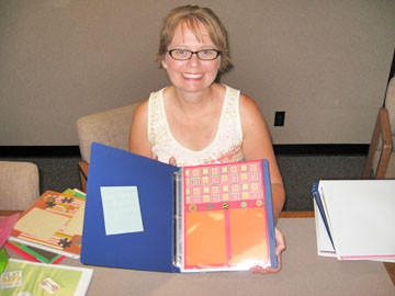 Michelle Stuck's interest in scrapbooking was inspired when she and her husband, Nathan Stuck, adopted their daughter, Kathy Stuck, at age 10.