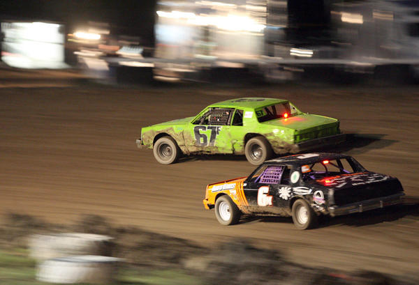 In action from last season at the Brown County Speedway, the Pure Stock cars of Jamie Moulsoff (6X), bottom, and Colton Fryer (67F), top, head into a turn. Moulsoff is currently sidelined after her car was involved in a wreck at the speedway, but she hopes to return to the track this season. Auto racing continues at Brown County Speedway tonight at 7:30 p.m.