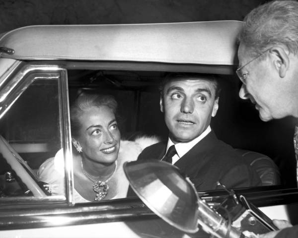 In this 1948 photo, Hollywood attorney Greg Bautzer arrives at Ciro's with Joan Crawford in one of the Cadillacs she gave him.