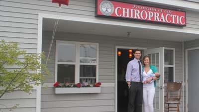 Chiropractor Justin Fountain (from left), his wife and practice manager Cheyenne and their daughter, Lakelyn, are shown outside the new Fountain of Life chiropractic office in Petoskey.