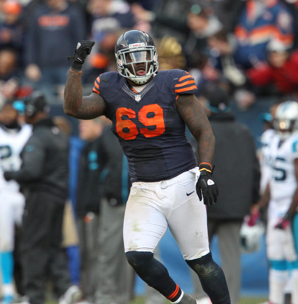 Defensive tackle Henry Melton pumps his fist after forcing Panthers quarterback Cam Newton to get rid of the ball late in the fourth quarter.