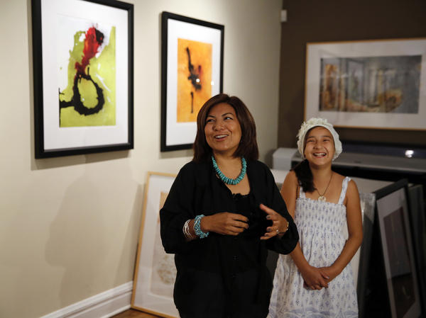 Artist Penelope Osio-Brown and her daughter Isabel, 10, are delighted that thirteen stolen pieces of her artwork was returned to her at her Osio-Brown Studios in Elmhurst.