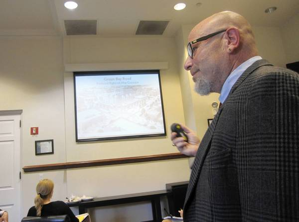 Highland Park Senior City Planner Lee Smith makes a presentation to the City Council during a July 8 Committee of the Whole meeting about recommended downtown zoning changes that include more density, taller buildings and fewer parking requirements.