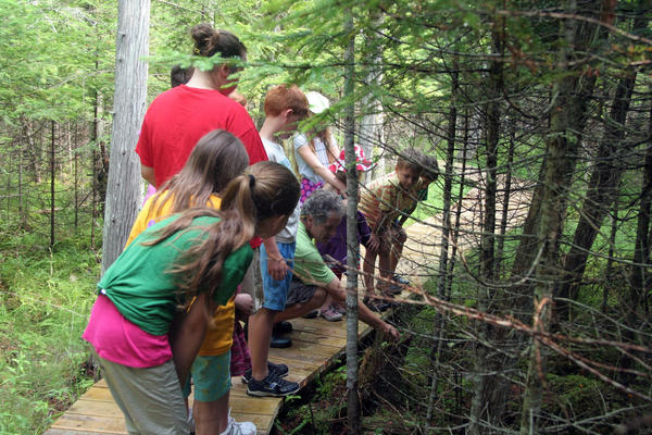 Children pay attention to the nature guide during a program at Thorne Swift Nature Preserve.