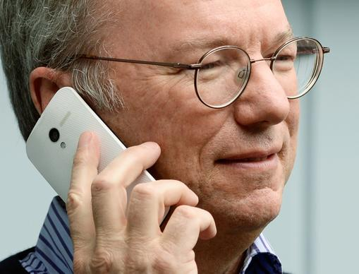 Eric Schmidt, executive chairman of Google, makes a call on the still-to-be-released, Google-produced Moto X phone.