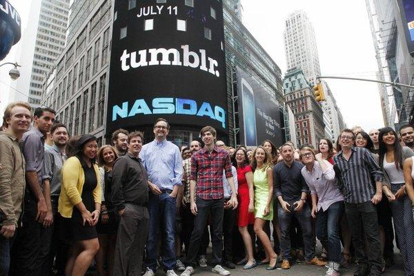 David Karp, center in plaid shirt, founder and chief executive of Tumblr, poses for photos with Tumblr employees in front of Nasdaq in Times Square after ringing the opening bell.