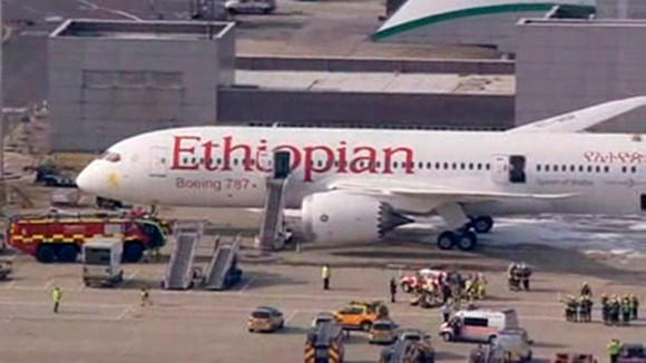 Emergency crew surrounds a Boeing 787 Dreamliner, operated by Ethiopian Airlines, which caught fire at Britain's Heathrow airport in this July 12, 2013 still image taken from video.
