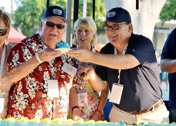 Jack Hammett, former Costa Mesa mayor and Pearl Harbor veteran, cuts cake with current Mayor Jim Righeimer at the city's 60th anniversary birthday celebration.