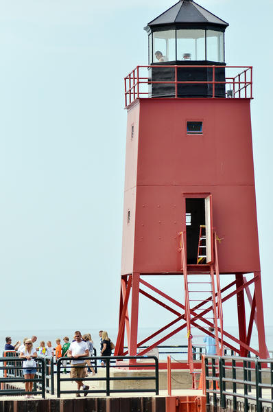 A worker from Mihm Enterprises works in the lantern room atop the Charlevoix south pier lighthouse on July 3.