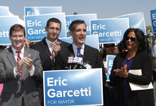 Then-Los Angeles mayoral candidate Eric Garcetti holds a news conference along with three former mayoral candidates who endorsed him: Kevin James, left, Emanuel Pleitez and Jan Perry at Barnsdall Park in April.