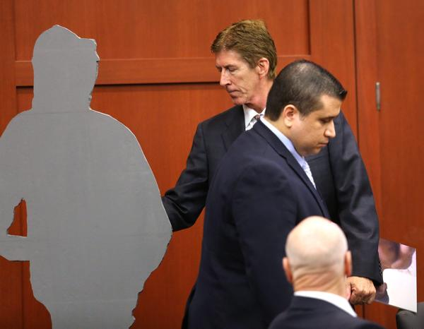 Defense counsel Mark O'Mara, center, uses a life-size cutout representing Trayvon Martin to compare to George Zimmerman, standing at right, during closing arguments.