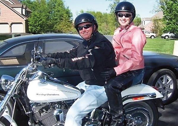 Jennifer Kelly rides with Dave Carroll during a benefit ride in 2007 that was held to help pay her medical expenses. Carroll had a helmet made for her and each year the memorial ride is held, the helmet is on the front of Carrolls bike.