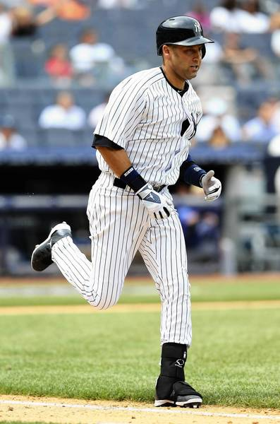 Derek Jeter #2 of the New York Yankees runs to first base in the sixth inning against the Kansas City Royals on July11,2013 at Yankee Stadium in the Bronx borough of New York City.