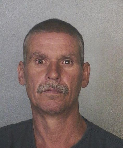 Carl Farmer, 48, is charged with murder after being accused of punching his drinking buddy Gregory Payea and leaving him for dead in Hallandale Beach.