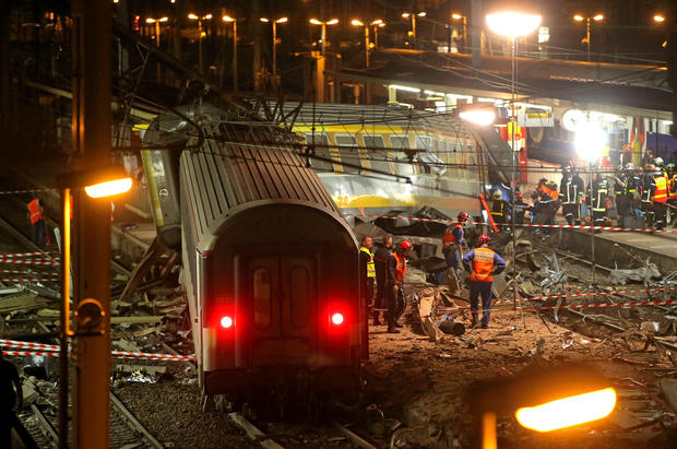 A derailed train car rests at the station in Bretigny-sur-Orge, 12 miles south of Paris. The packed passenger train skidded off its rails soon after leaving Paris, leaving at least six dead and dozens injured, authorities said.