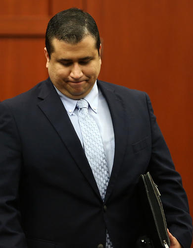 George Zimmerman leaves the courtroom at the end of the day during his trial in Seminole circuit court in Sanford, Fla. Friday, July 12, 2013. Zimmerman has been charged with second-degree murder for the 2012 shooting death of Trayvon Martin. The jury asked to recess until morning to continue deliberations.