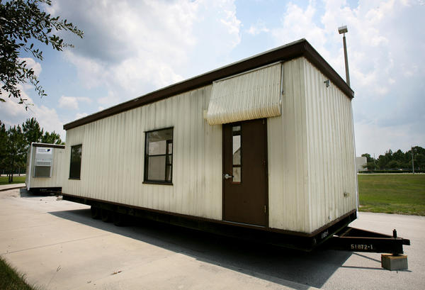 Two portables rest out front of Odyssey Middle School Orlando in June 2010. Crews were on hand moving the portables allowing the army corps to search further for unexploded bombs.