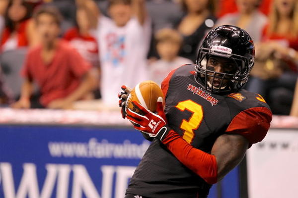Orlando Predators' Jason Geathers catches a pass during the Arena Football League Game between the visiting Cleveland Gladiators and the Predators at the Amway Center on June 15, 2013.