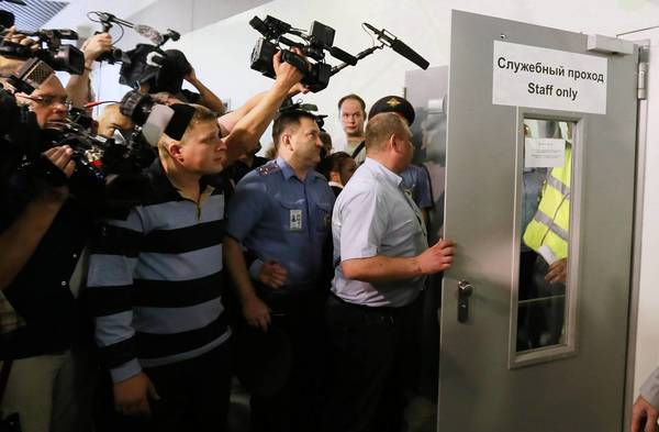 Airport police guard an entrance to the transit area of Sheremetyevo International Airport in Moscow, where former NSA contractor Edward Snowden has been holed up for nearly three weeks.