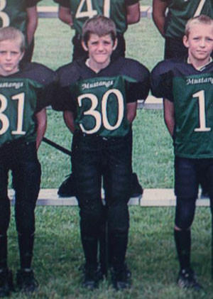 Grant McKee in a Pop Warner football team photo when he was about 11 years old.