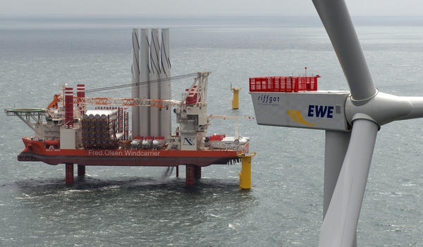"The jack-up installation vessel ""Bold Tern"" stands near the Riffgat offshore wind farm in the North Sea near Borkum, Germany. The Riffgat facility, which includes 30 turbines, is expected to provide power to 120,000 households."