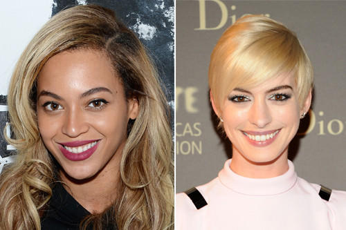 Singer Beyoncé, left and actress Anne Hathaway show off their blonde hair.