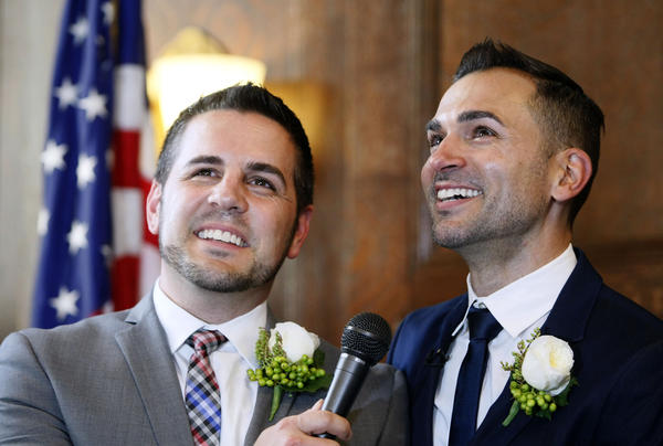 Jeff Zarillo, left, and his partner Paul Katami, right, speak to the media after wedding ceremony officiated by L.A. mayor Antonio Villaraigosa at City Hall in Los Angeles on Friday, June 28, 2013.