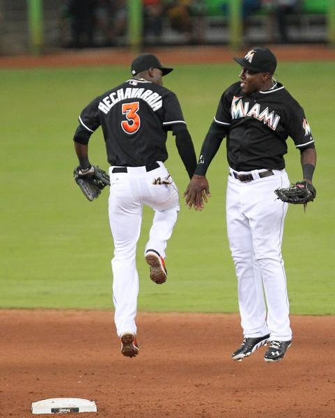 Miami Marlins shortstop Adeiny Adeiny Hechavarria,(3) celebrate with teammate with Miami Marlins center fielder Marcell Ozuna after defeated the Washington Nationals 8-3 of the game at Marlins Park in Miami on Friday, July 12, 2013.