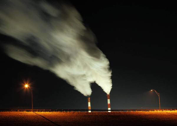 The president has proposed stricter standards for coal-fired power plants such as the one in Kansas pictured here.
