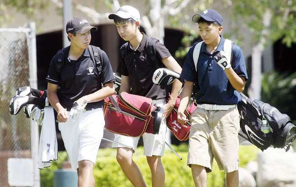 ARCHIVE PHOTO: LA Cañada High's Collin Morikawa, from left, Joshua Suh and Crescenta Valley's Paul Park all received All-Area Boys' Golf honors.