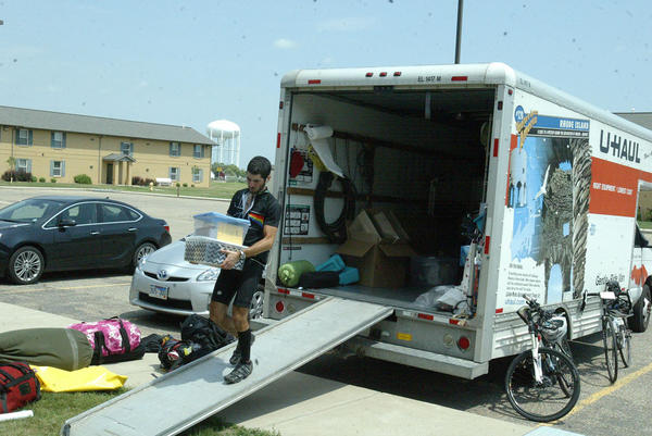 Arye Zucker, one of the participants in the Hazon bike ride across America, unloads some of the group's belongings Friday afternoon at Presentation College. Zucker is a Dallas native who recently graduated from the University of Maryland.