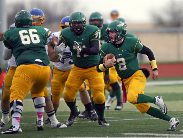 Presentation College's Stephen Braswell (2) cuts back to the middle of the field as teammates Dave Dubreuse (66) and Blake Olson (71) block for him last season. American News File Photo by John Davis