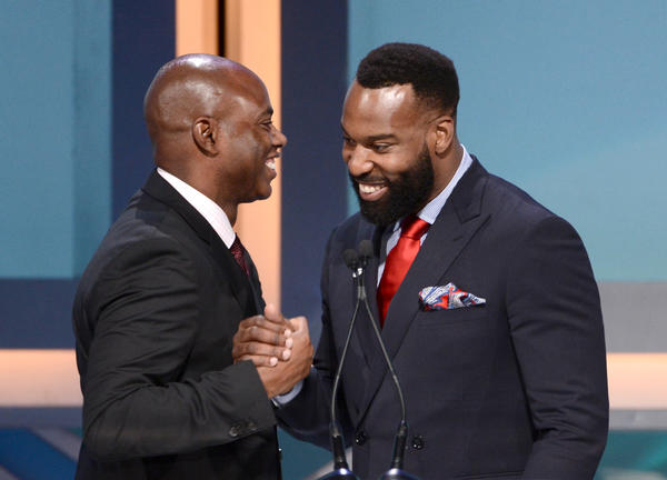 A bearded Baron Davis is greeted by host Kevin Frazier during the 28th Anniversary Sports Spectacular Gala.