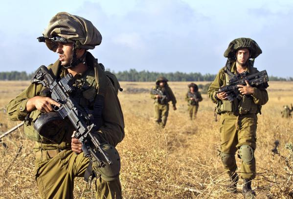 Israeli soldiers take part in a military exercise in the Golan Heights, near the border with Syria, in June. Israel would not comment on reports that its jets carried out an airstrike on a Syrian port city last week.