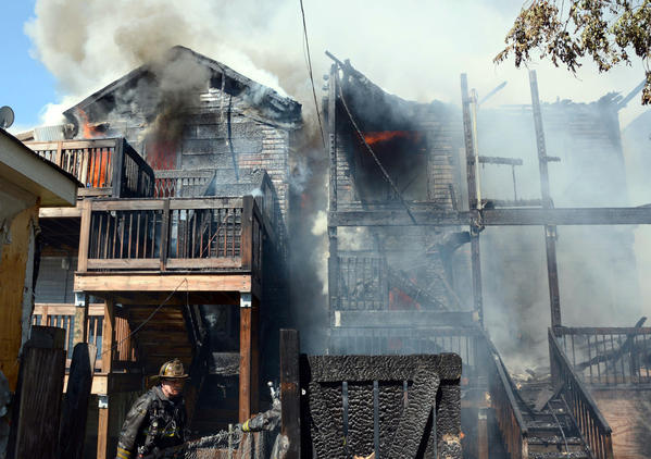 Chicago firefighters battle a 3-11 alarm fire in the 4400 block of South Union Avenue Saturday.